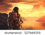 hiking girl with backpack is... | Shutterstock . vector #227469253