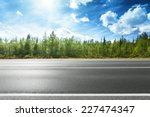 asphalt road and forest | Shutterstock . vector #227474347