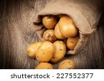 raw potatoes in the sack on... | Shutterstock . vector #227552377