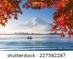 Stock photo autumn season and mountain fuji with morning fog and red leaves at lake kawaguchiko japan 227582287