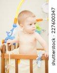 baby boy waving hand and...   Shutterstock . vector #227600347