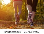 fitness girl running at sunset... | Shutterstock . vector #227614957