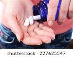 pills in hand  close up | Shutterstock . vector #227625547