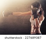 strong athletic woman with... | Shutterstock . vector #227689387