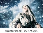 Young Blond Woman In A Blizzar...