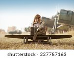 young aviator sits in his... | Shutterstock . vector #227787163