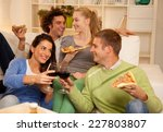 four friends having dinner at... | Shutterstock . vector #227803807