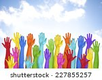 colorful hands raised with blue ... | Shutterstock . vector #227855257