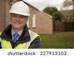 smiling building site foreman | Shutterstock . vector #227913103