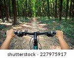 mountain biking down hill... | Shutterstock . vector #227975917