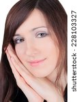 pretty girl touching her face | Shutterstock . vector #228103327