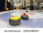 curling stone on ice of a... | Shutterstock . vector #228148003