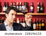 man tasting a glass of red wine | Shutterstock . vector #228196123