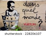 Small photo of PARIS FRANCE OCTOBER 19: Street art poor child VS Vuitton Paris France october 19 2014. Paris is the perfect place to walk in the back alleys and abandoned areas, looking for fresh air and street art.