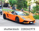 Постер, плакат: Orange supercar Lamborghini Gallardo