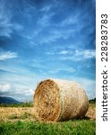 Small photo of haybale at a field - photo