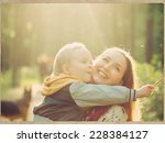 family mother with child son in ... | Shutterstock . vector #228384127