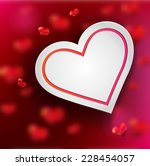 white heart on red background... | Shutterstock .eps vector #228454057