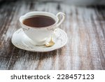 cup of tea on wooden background | Shutterstock . vector #228457123