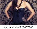 woman wearing black corset and... | Shutterstock . vector #228607303