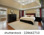 Small photo of Master bedroom in luxury home with view into bathroom