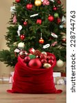 Red Bag With Christmas Toys An...
