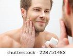 handsome unshaven man looking...   Shutterstock . vector #228751483