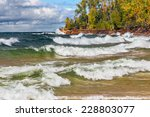 Waves Crash On The Rocky Coast...
