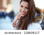 Beautiful Young Woman Smiling...