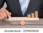 midsection of businessman... | Shutterstock . vector #229003033