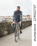 hipster man riding in a fixie... | Shutterstock . vector #229022737