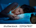 Woman Sleeping In A Bed In A...