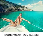 happy couple relaxing on a boat ... | Shutterstock . vector #229468633