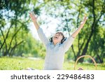 young joyful boy in summer park ...   Shutterstock . vector #229486483