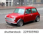 Small photo of AMSTERDAM, NETHERLANDS - AUGUST 10, 2014: Retro car Austin Mini Cooper at the city street.