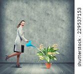 businesswoman with can watering ... | Shutterstock . vector #229537153