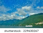 ferry on green mountains and... | Shutterstock . vector #229630267