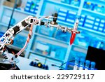 robot manipulates chemical... | Shutterstock . vector #229729117