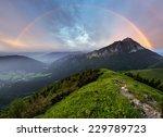 rainbow over mountain peak | Shutterstock . vector #229789723