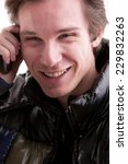Small photo of portrait oaf a good looking young man phoning on a mobile phone