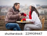 romantic young couple drinking... | Shutterstock . vector #229939447