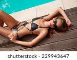 beautiful woman sunbathing at a ...   Shutterstock . vector #229943647