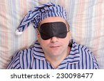 man sleeping with a mask on... | Shutterstock . vector #230098477