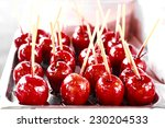 gleaming red candy apples at... | Shutterstock . vector #230204533