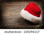 red santa claus hat on old... | Shutterstock . vector #230296117