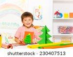 small boy holds carton xmas... | Shutterstock . vector #230407513
