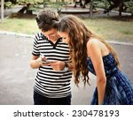 happy guy and girl  looking at... | Shutterstock . vector #230478193