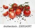 fresh ripe tomatoes on a white... | Shutterstock . vector #230514397