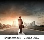 Rear View Of Businessman With...