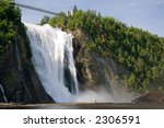 The Montmorency Falls, or Chutes Montmorency in French, is one of the most popular tourist attraction in Quebec city. This image is from an angle that is not accessible from the park's regular trails. - stock photo